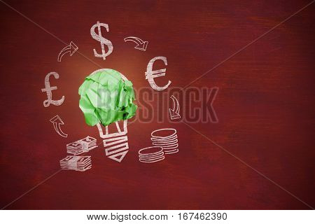 Digitally composite image of green crumpled paper against image of a desk