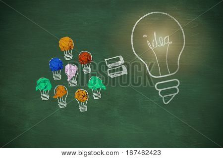Digital image of yellow crumpled paper against green chalkboard