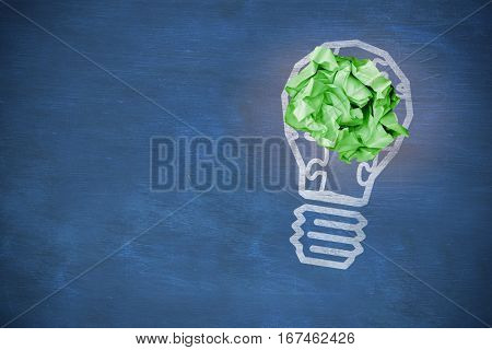 Digital image of green crumpled paper against blue chalkboard