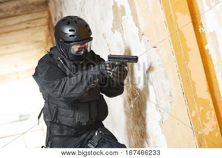 Anti-terrorist police soldier armed with pistol ready to attack
