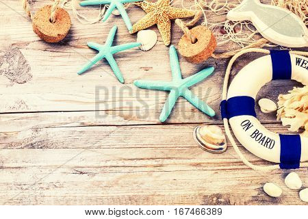 Summer holiday frame with seashells and beach accessories. Summer background with copy space
