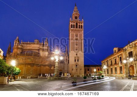 Famous Bell Tower named Giralda in landmark catholic Cathedral Saint Mary of the See at night, Seville, Andalusia, Spain