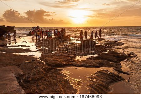 TANAH LOT INDONESIA - January 22 2013. People meet sunset on the coast near the Tanah Lot temple.