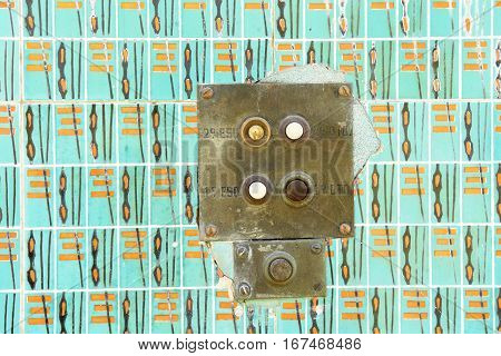 close up of a Old intercom and tiles