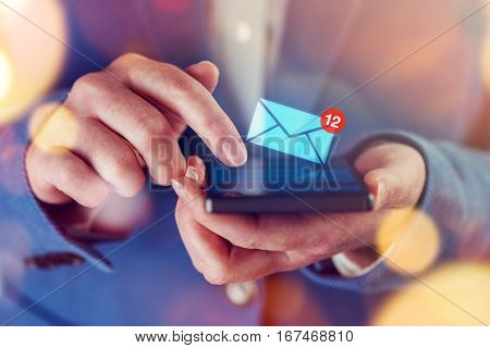 New messages on mobile phone female finger opening inbox to view the pending e-mail communication