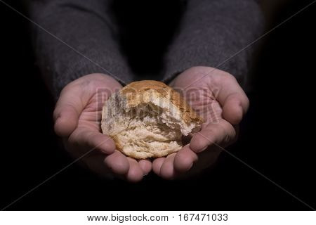 Sharing Bread. Poverty Concept.
