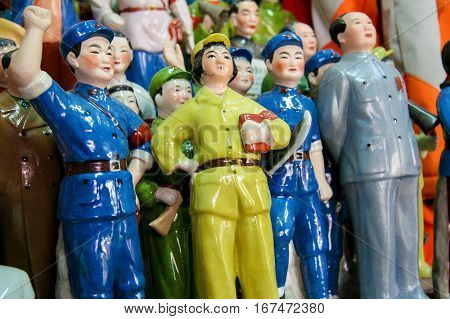 BEIJING CHINA - SEPTEMBER 17 2007: Statues of Mao and other communist memorabilia on an antique market in Beijing China