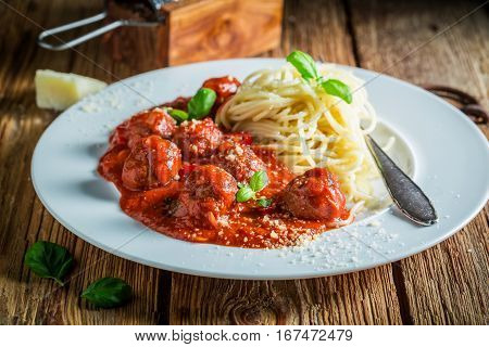 Tasty Pasta Bolognese With Meatballs And Parmesan