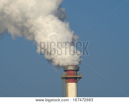 smoky chimney on background of blue sky