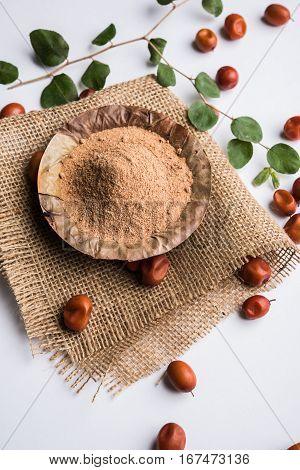 Organic powder of Indian Jujube or ber or berry (Ziziphus mauritiana) moody lighting, selective focus