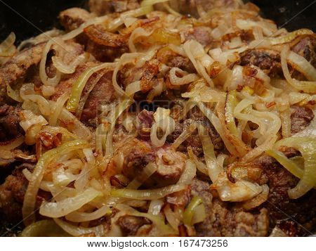 fried liver with onion in a pan