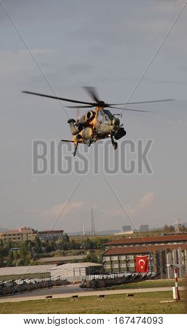 ANKARA, TURKEY - JUNE 10 2014 : T129 ATAK Helicopter over the apron of Turkish Land Forces Aviation Command