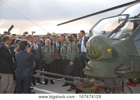 ANKARA, TURKEY - JUNE 10 2014 : Turkish Prime Minister Recep Tayyip Erdogan, Turkish President Abdullah Gul and VIP Persons (in flight jackets) on the apron of Turkish Land Forces Aviation Command