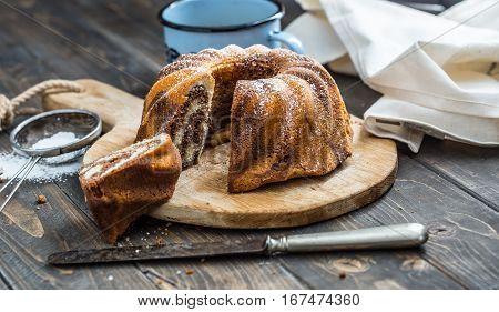Cake. Marble cake cup of coffee powder sugar kitchen vintage utensil and fresh fruit berries.