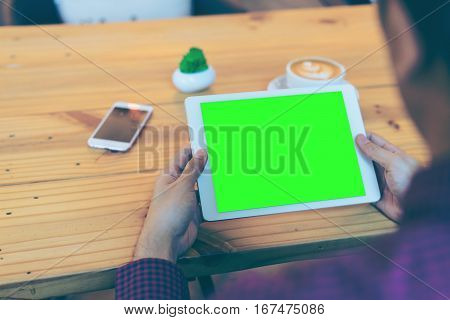 Businessman Reading His Tablet With Green Screen (cliping Path)