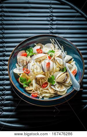 Delicious Spaghetti Vongole Made Of Clams, Peppers And Parsley