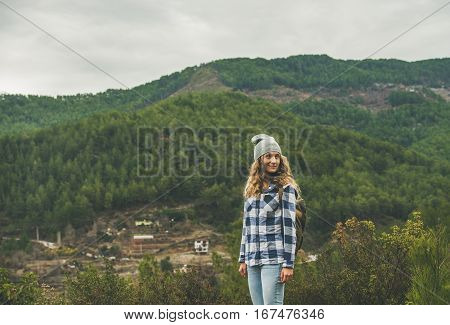 Young woman traveler in chekered shirt hiking in the mountains, Dim Cay district of Alanya, Antalya province, Mediterranean Turkey