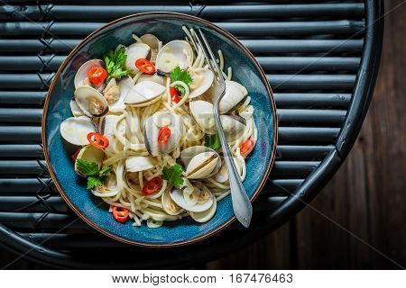 Enjoy Your Spaghetti Vongole With Clams, Parsley And Peppers