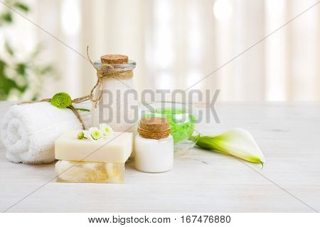 Composition of spa wellness products on light wooden background