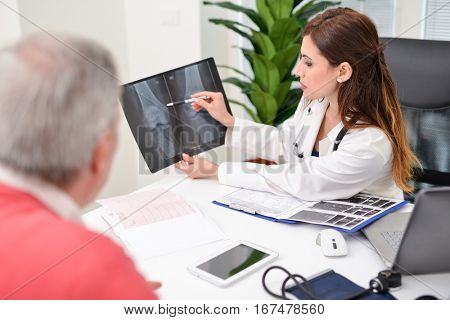 Doctor showing a radiography to a patient