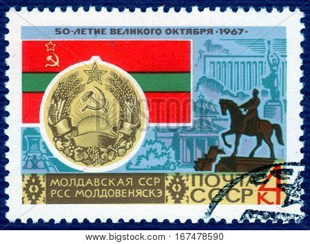 USSR - CIRCA 1967: post stamp printed in the USSR shows Coat of Arms, Flag and monument  Moldovan SSR, serie