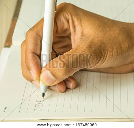 man is writing love letter to his lover