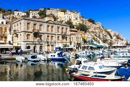 SYMI, GREECE-SEPTEMBER 27, 2016: Picturesque harbor with colorful houses of Symi town, Dodecanese, Greek island