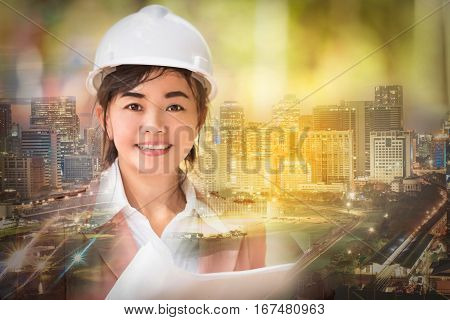 double exposure and soft focused executive Asian engineer woman and cityscape scene business environment engineer concept