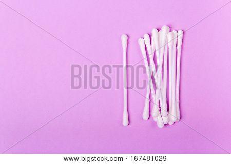 closeup clean ear sticks on violet background slide