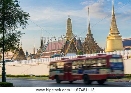 Bangkok Grand Palace  And Bus Running Pass The Street In Front The Palace In Bangkok, Thailand.