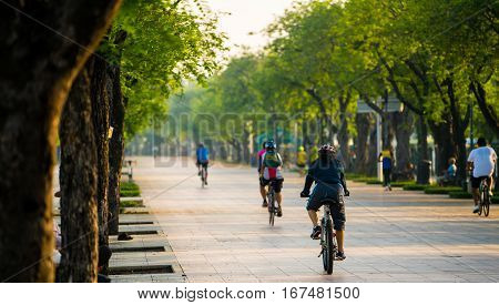 People on bicycle in public park excercise