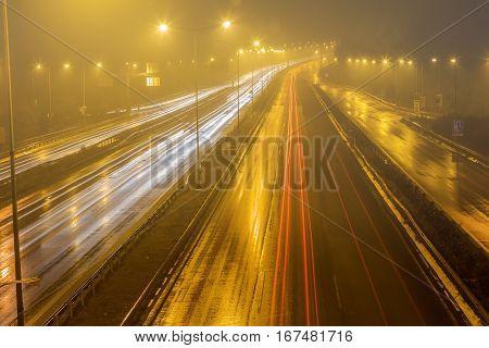 Speed Traffic - Light Trails On Motorway Highway At Night