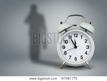 Clock with businessman shadow time management concept