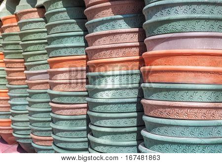 Earth Tone Color of Ceramic Pots Background, Green Orange, Brown and Pink