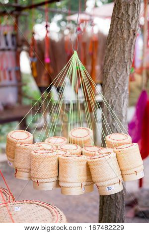 bamboo container for holding cooked glutinous rice Thailand. It use in most northeast of Thailand