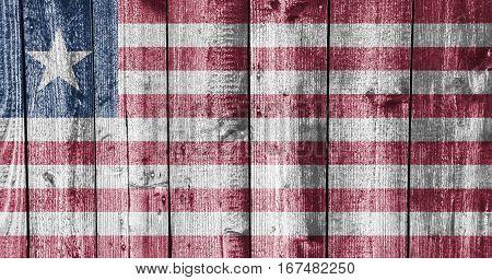 Colorful and crisp image of flag of Liberia on weathered wood