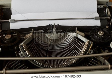 blank sheet of paper ready to type words on a Vintage Typewriter
