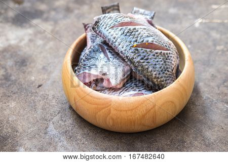 Tilapia fish ready for cooking ingredients. Dieting and healthy ingredients ready to prepare meal.