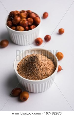 Organic powder of Indian Jujube or ber or berry (Ziziphus mauritiana) moody lighting, selective focus