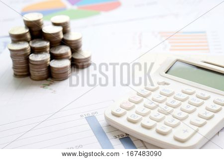 Coins chart and calculator as a symbol for exchange rates.
