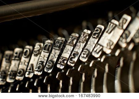 Closeup of an old typewriter letters and symbols