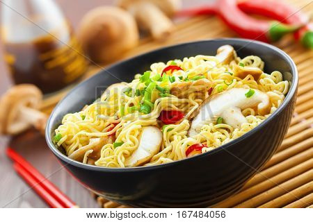 Instant noodles with shiitake mushrooms in a bowl Asian traditional food