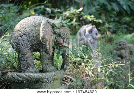 Old stone statue of an elephant in the jungles of Taiwan