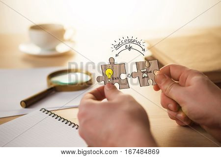 Building a business success. Concept for consulting, marketing, business, strategy and planning. The male hands with puzzles