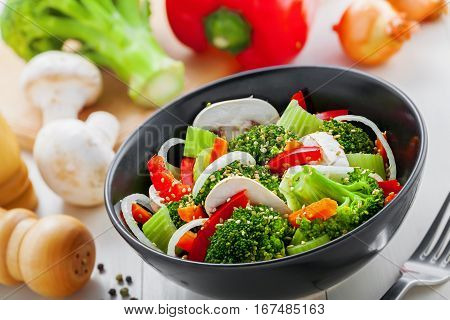 Steamed broccoli with vegetables. Vegetable salad in bowl. International healthy vegetarian food.