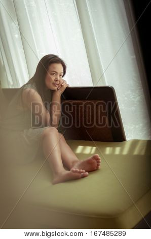 Woman relaxing on sofa in living room