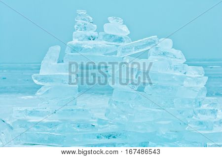 Winter scene at a frozen lake with buildup made of ice bricks