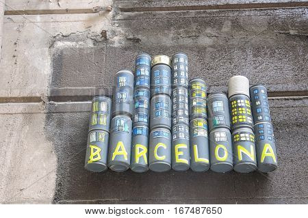 BARCELONA - JUNE 4: Tribute to Barcelona city on June 6 2016 in Sant Pau street Barcelona Spain. The tribute is made with recycled cans and painted.