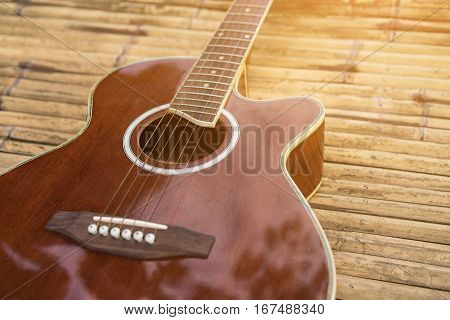 Acoustic Guitar Placed On A Wooden Table