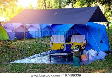 Tent camping with cookware and gas in the park.